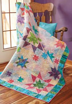 Three different size stars are featured in this throw quilt pattern! Use batik fabrics to add dimension to this fun, cosmic quilt.