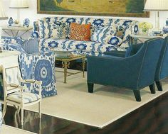 Schumacher's Samarkand Ikat and a Quadrille floral look great together, but I would have done more with the throw pillows. The self-fabric bolsters and pillows disappear into the print, leaving one lonely coral pattern looking lost in the middle. Home Depot Paint, Floral Sofa, Simple Living Room, Painted Sticks, Blue Fabric, Ikat Fabric, Fabric Wallpaper, Beautiful Interiors, Decorating Your Home