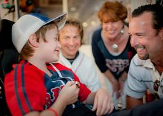 Former @Boston Red Sox pitcher Tim Wakefield meets with @The Jimmy Fund patient Ian at the 12th annual WEEI/NESN Jimmy Fund Radio-Telethon. Wakefield even lent his World Series ring to Ian for a few special photos. #KCANCER #RedSox Photo credit: Metrodesign