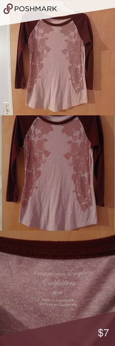 American Eagle Raglan Tee Burgundy raglan style tee. Very soft. Worn a handful of times. No snags, tears. Very see-thru, suggest a cami, bandeau, or nude bra when wearing. American Eagle Outfitters Tops Tees - Long Sleeve
