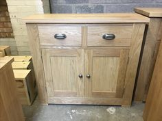 A bespoke oak small sideboard. Cobwebs Furniture Company.