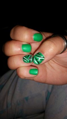 Green nails with zebra prints