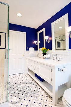 Love the contrast of white and cobalt blue in a simple, classic style... and those floors are amazing!