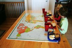 Geography Ideas.....love this idea. Put a map on the table and the kids will learn while eating, playing, ect!