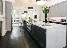 The Mayfair mansion comes with a massive long kitchen with French doors opening onto a private garden. Long Kitchen, Kitchen Board, House Prices, Decorating Tips, Decorating Websites, French Doors, Home Interior Design, Living Room Designs, Property For Sale