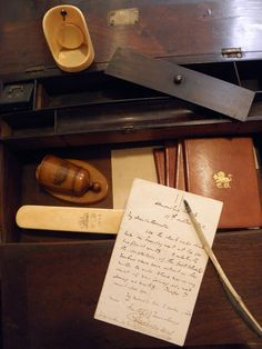 Charles Dickens' personal belongings, ivory pocket watch stand, match keeper, hat brush, small albums, handwritten manuscripts, and quill pen are part of the collection in the Small Special Collections Library at U.Va.                                       All photos by Donna Stapley.