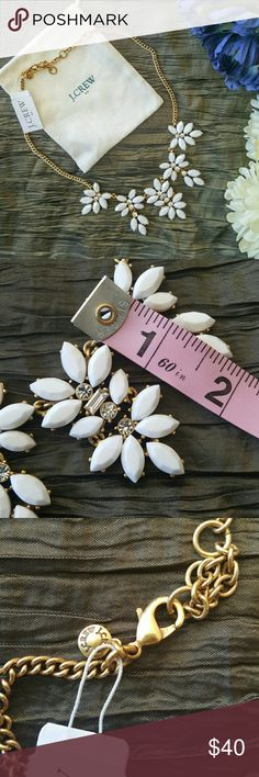 "🌻SALE!🌻 NWT J. CREW | WHITE FLORAL NECKLACE * Whether it's dressing up a crew neck sweater or topping a strapless dress, you'll be sure to sparkle! * These stones create a perfect statement in a feminine floral design * Light gold plating * Signature J. Crew stamp on hanging charm  * Length: 17"" with a 3"" extender chain for adjustable length * Brand new with tags and dustbag. Other styles available in separate listings so take a look!  Over 150 items listed so bundle to save more! J. Crew…"