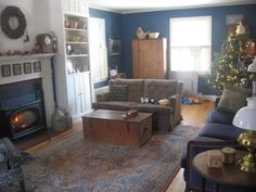 this enormous living room in the restored 1948 cape cod style home