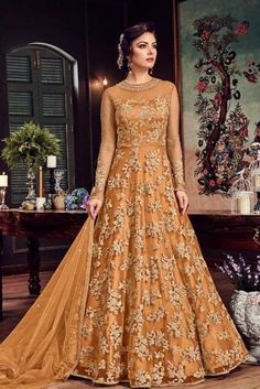 Orange Designer Anarkali Salwar Suit- Explore Wide Range of Latest Designer Anarkali Salwar Suit Online in India @ YOYO Fashion.♥ Latest Frock Suit Designs ♥ COD ♥ New Anarkali Suit Designs Shadi Dresses, Indian Gowns Dresses, Pakistani Dresses, Net Dresses, Indian Designer Outfits, Indian Outfits, Designer Dresses, Pakistani Wedding Outfits, Bridal Outfits