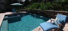 Picture yourself lounging by this rectangular pool design with spa and a stone wall with waterfalls. Swimming Pool Designs, Swimming Pools, Rectangular Pool, Blue Pool, Luxury Pools, Pool Builders, Aqua Blue, Waterfalls, South Carolina