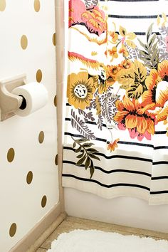 Polka Dot Bathroom Walls | Sarah Hearts I am loving the florals on top of stripes right now + gold polka dots! I want!!