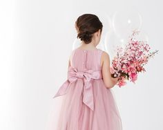 Detail shot of Paul Costelloe's pink flower girl dress, also available in white and ivory