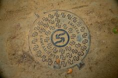 manhole Sevilla, Spanje, manhole, manhole cover, stan de haas, kanaldeckel, gullydeckel, asphalt, background, circle, city, cover, detail, drain, grate, gray, hole, iron, metal, old, pavement, road, round, sewage, sewer, sidewalk, steel, street, symbol, underground, urban, water, putdeksel http://www.standehaas.com https://www.facebook.com/pages/Stan-de-Haas-Photography