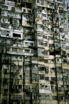 """Desolate  apartment building on Hashima Island  aka  Battleship Island, Japan. The island was  an overcrowded  mining facility until 1974, when it was abandoned to the elements."""