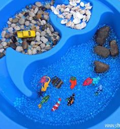 Ocean Sensory Table- i guess i could use masons chewed up water table for sensory projects! stupid dogs!