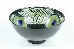 A William Moorcroft pottery bowl, tubelined to the interior with 'peacock feather' pattern in gr...