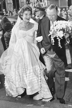 Jacqueline Kennedy's Ann Lowe-designed wedding gown didn't disappoint: Fifty yards of silk taffeta made up the bodice and skirt, which Jackie wore along with her grandmother's pared-down veil.