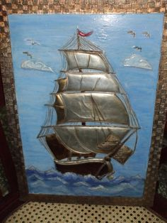 Repujado en metal,sobre madera.Coloreado con acrilica y betun de judea.