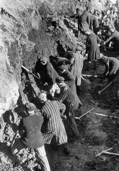 Two new histories show how the Nazi concentration camps worked // Prisoners break up clay for the brickworks at Sachsenhausen-Oranienburg, in 1939.