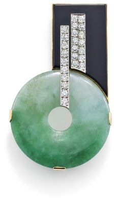 An Art Deco jade, diamond and onyx pin, 1930    The jade disc offset below an onyx plaque and applied old brilliant-cut diamond linear motifs, Austrian assay marks to rear, length 6.2 cm, c. 1930. (hva)
