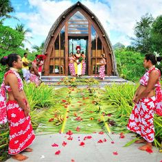 Now this is colour! The Polynesian wedding chapel at @Four Seasons Resort Bora Bora was decorated with palm fronds and fire-red hibiscus flowers for one couple's destination wedding.