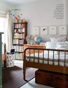 Vintage Jenny Lind bed, gray walls, pops of color from globe, books, art, Mobile