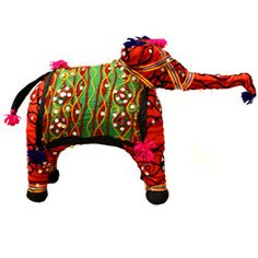 """Handmade in India using traditional production techniques, this brightly-colored cloth elephant is adorned with beads, ribbon, yarn, and several different fabrics. A one-of-a-kind gift for the pachyderm-lover in your life!    Approximately 12"""" tall, 14"""" trunk to tail."""