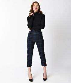 Prepared to go anywhere, dolls! A pristine pair of plaid cigarette capris in a 1950s high waist cut, the Livingstone pants from Hell Bunny are a midcentury minded frock in a soft fabric blend. A lush navy blue tartan adds playful flair while a back zipper