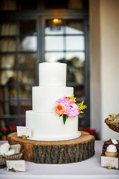 white cake with simple floral details...plus a personal cake topper (lil Piggies