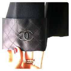 Chanel top/ open to offers!!! Wide neck 3/4 sleeve black Chanel top. It has a woven neck and cuff trim with the iconic cc emblem on cuffs. This top is from Chanel can not be bought in stores. Only some employees receive this top. Made of 65%rayon, 32%nylon and 3% spandex. It's a beautiful thick knit with a little stretch. Would be a great basic black top to have in any closet!!  Open to offers!! CHANEL Tops