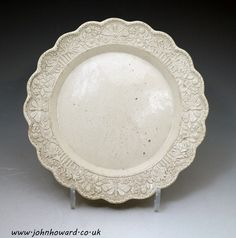 Stoneware saltglaze plate with relief decorated border , mid 18th century Staffordshire England