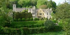 owlpen manor estate, near tetbury. attractive building and gardens, can hire cottages individually to sleep up to 40 guests and can be married in COE church near house but requires quote but catered by their restaurant and can't use main house.
