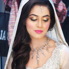 Bridal look by Natasha Salon in Pakistan. Love the gold sparkly eyes, subtle cheeks and hot pink lips