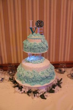 Tiffany Blue Rosette wedding cake. With Black and White accents and blue pearls
