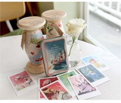 10 petites bo/îtes postales en carton de 6 x 6 x 6 cm.