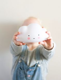 Mini Cloud Light By: A Little Lovely Company Color: White & Blue Description: So cute, this white mini cloud light! These eco-friendly lights are child safe and made from BPA- and phthalate free PVC; and give a soft glow when turned on. Because there is a LED-light in it, the material doesn't get hot and can be safely used by children.  We advise you to use the timer option, because the included batteries last for about 20 hours. sold@Mintedmethodshop.com