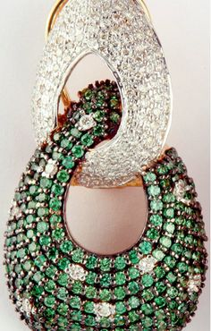 Emerald and Diamond earrings by Inaaya