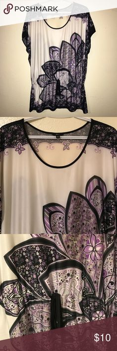 Milano floral abstract print top 💜 Beautiful crinkle silky short sleeve blouse. Semi Sheer material. Very light and airy. The perfect blouse to wear during your weekend get away at the beach. Rounded deep neck with a drawstring around waist & tie at front. 95% Polyester 5% Spandex. Machine wash cold separately. NWOT. Excellent conditions. From a smoke free, dog friendly home💜 Milano Tops Blouses