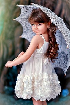 she is melting my heart......gorgeous young lady w/parasol