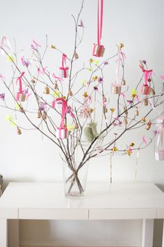 Wedding Favor Tree - Could we get away with one on each table? Spray paint black and dust with silver glitter and hang favors - small candy, bird seed heart ?
