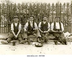 Four workers enjoy a break for lunch c. An amusing nineteenth century sepia photograph from M&N Publishing 1940s Mens Fashion, 1890s Fashion, Naval Tattoos, Pioneer Clothing, Man Dressing Style, Victorian Photos, Victorian Costume, Pictures Of People, Working Class