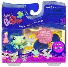 """Littlest Pet Nook: Frog in Party Shop by Hasbro Toy. $7.99. Ages 4 +. Everyday's a party with this fancy frog friend and her sassy party hat! She's hoppin' to it to get everything she needs for a pet-lovin' party in this sweet shop! Best of all, you can collect all of the Play and Display Pet Nooks (each sold separately) and stack them or attach them side by side to create your very own Littlest Pet Shop world. Party shop comes with 1.5""""H frog pet and party ha..."""
