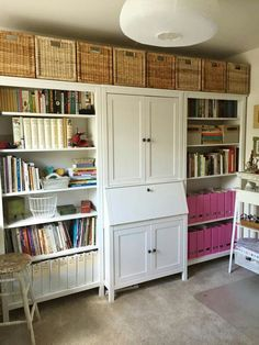 This in the living room. Storage and a little office space that can be concealed when not in use. Ikea Hemnes.