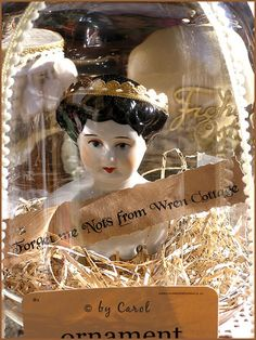 china doll in glass dome