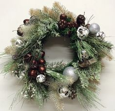 Winter wreath with brown cherries, silver baubles and bells. Miss Haberdash Christmas.