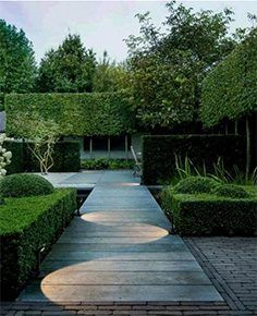 If you are looking for an outdoor home improvement project, consider outdoor walkway lighting. Walkway lighting is important in making the path visible at night. Modern Landscaping, Outdoor Landscaping, Landscaping Ideas, Outdoor Gardens, Outdoor Walkway, Walkway Ideas, Hillside Landscaping, Stone Walkway, Paving Stones