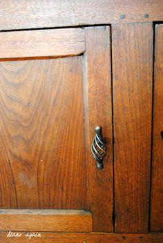 living room. detail of black walnut cupboard. birdcage pull.
