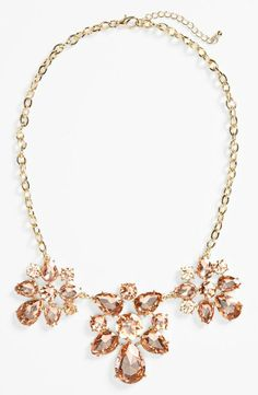 Such a gorgeous splash of sparkle! Love this champagne cluster statement necklace.
