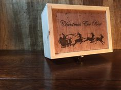 This Christmas Eve Box can be personalised with a name and font. We also have other images. Contact us or visit our website for more details
