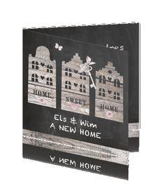 Verhuiskaart krijtbord houten huisjes grachtenpanden met sleutel